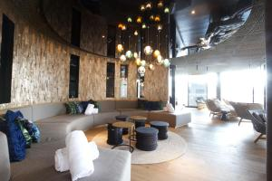 The lounge or bar area at The Hide Flims Hotel