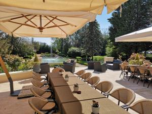 Restaurant ou autre lieu de restauration dans l'établissement Chateau De Rilly - Les Collectionneurs