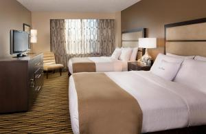A bed or beds in a room at DoubleTree Suites by Hilton Austin