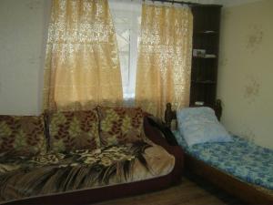 Кровать или кровати в номере Apartment in Pyatigorsk