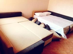 A bed or beds in a room at Appart H36