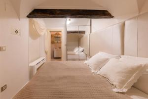 Postelja oz. postelje v sobi nastanitve AB Ljubljana - The Residence