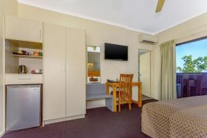 A television and/or entertainment center at Quality Hotel Darwin Airport