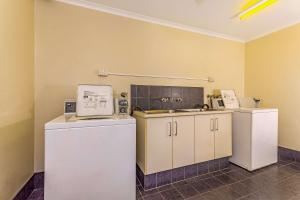 A kitchen or kitchenette at Quality Hotel Darwin Airport