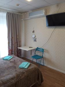 A television and/or entertainment center at FullHouse Hostel