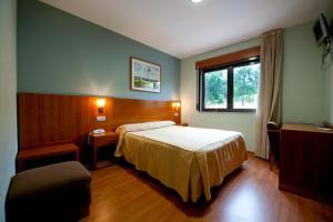 Cama o camas de una habitación en Hotel O Noso Portosin