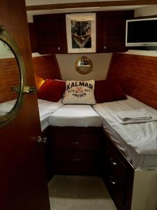 A bed or beds in a room at Motor yacht