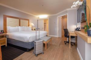 A bed or beds in a room at The Millwood