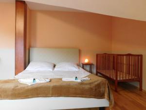 Łóżko lub łóżka w pokoju w obiekcie Willa na Stoku