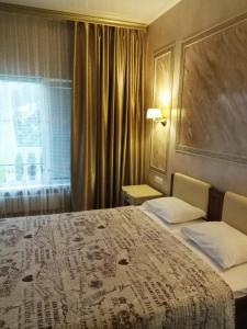 Кровать или кровати в номере Гостевой Дом Chinar