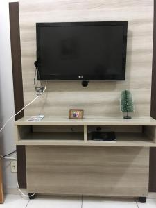 A television and/or entertainment center at Apartamento Duque de Caxias