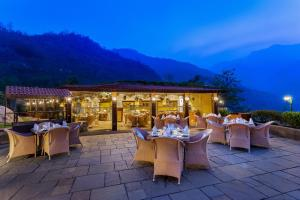 A restaurant or other place to eat at Aloha On The Ganges by Leisure Hotels