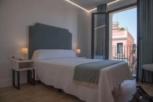 Cama o camas de una habitación en gm hotel