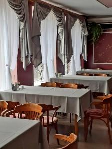 A restaurant or other place to eat at Gamma Hotel