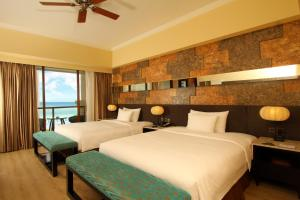 A bed or beds in a room at The Bellevue Resort