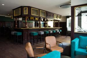 The lounge or bar area at City Hotel de Jonge