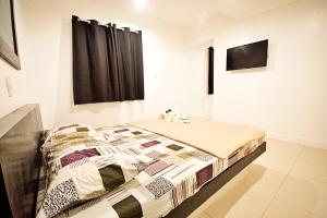 A bed or beds in a room at CJS Boracay Joint