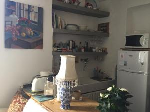 Cuisine ou kitchenette dans l'établissement La Cordière