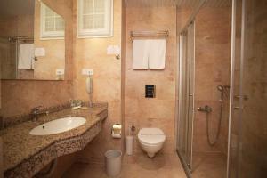 Ein Badezimmer in der Unterkunft Gardenia Hotel