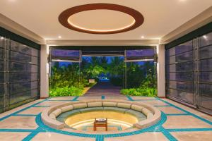 The swimming pool at or near Nilaveli Beachfront Penthouse by Oceanfront Condominiums