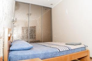 A bed or beds in a room at Fransuaza Apartments