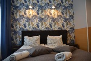 Łóżko lub łóżka w pokoju w obiekcie B&B La Fontaine