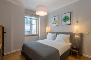 A bed or beds in a room at Urbano FLH Hotels Lisboa