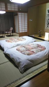 A bed or beds in a room at Senjukaku