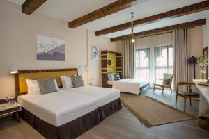 A bed or beds in a room at Park Regis Boutique Hotel