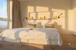 A bed or beds in a room at Noordzee, Hotel & Spa