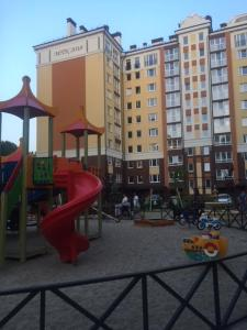 Children's play area at Апартаменты Новые