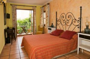 Llit o llits en una habitació de Hotel Restaurante La Masieta