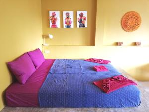 A bed or beds in a room at Good Time Sports Resort Koh Mak