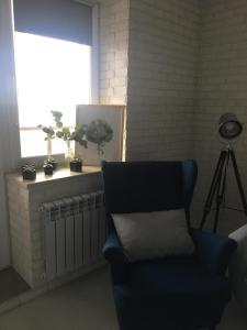 Гостиная зона в Apartment Zhemchuzhina Viktorii