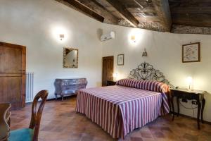 Letto o letti in una camera di Castello Di Caccuri Suites