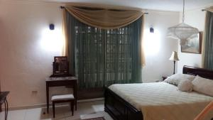 A bed or beds in a room at Bed & Breakfast