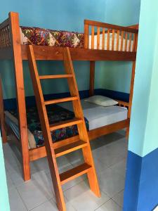 A bunk bed or bunk beds in a room at Surya Rainbow Villas
