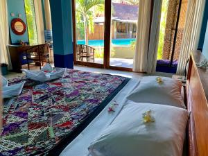 A bed or beds in a room at Surya Rainbow Villas