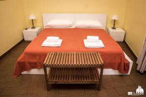 A bed or beds in a room at B&B La Muraglia