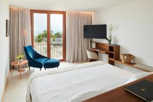 A bed or beds in a room at Es Princep - The Leading Hotels of the World