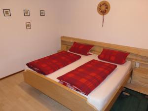 Ein Bett oder Betten in einem Zimmer der Unterkunft Untermetzgersbauernhof Alpirsbach