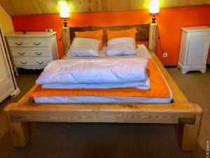 A bed or beds in a room at Gite De Montagne Les Sureaux