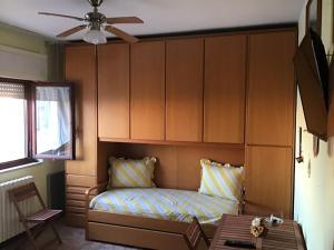 Letto o letti in una camera di Appartamento Calisi