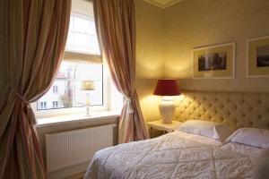Letto o letti in una camera di Hotel Apia