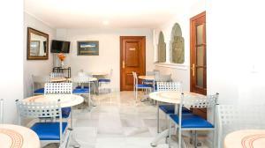 Un restaurante o sitio para comer en Hotel Albero