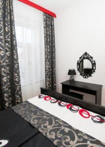 Postel nebo postele na pokoji v ubytování U Patrona Apartment