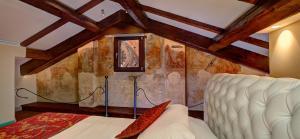 Ein Bett oder Betten in einem Zimmer der Unterkunft Art Hotel Commercianti