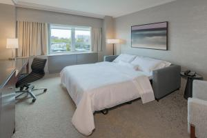 A bed or beds in a room at Westin Nova Scotian