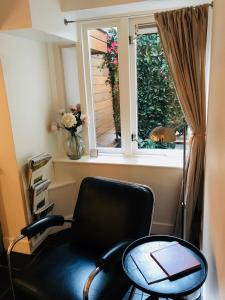 Ein Sitzbereich in der Unterkunft CoHo Apartment Suites