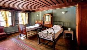 A bed or beds in a room at Guest House Old Plovdiv